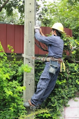 Electrician Working On A Pole